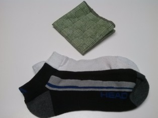 Cloth napkin and a mixmatched pair of warm socks
