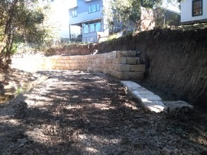 Retaining wall being built by the creek